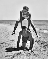 Young Couple Playing Leapfrog on the Beach by The Chelsea Collection